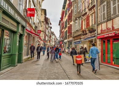 Bayonne, France - March 14, 2020; People strolling along the streets of the old town of Bayonne.