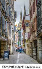 BAYONNE, FRANCE, MAY 16, 2017: People at a narrow street in the historical center of Bayonne, France