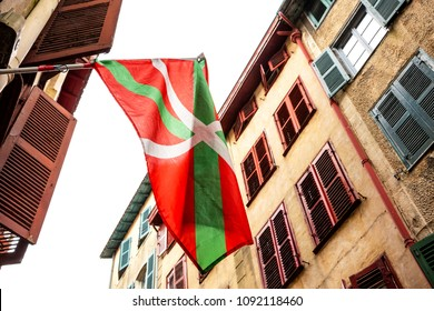 Bayonne (France). Waving Basque flag at narrow street of old city.