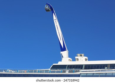 """BAYONNE, NEW JERSEY - NOVEMBER 18, 2014: The """"NorthStar"""" observation tower at the newest Royal Caribbean Cruise Ship Quantum of the Seas docked at Cape Liberty Cruise Port"""