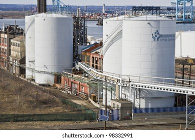BAYONNE, NJ/USA-MARCH 9: Oil storage tanks and old factories along Newark Bay on March 9, 2012 in Bayonne, NJ. The location is a center for oil storage and international shipping.