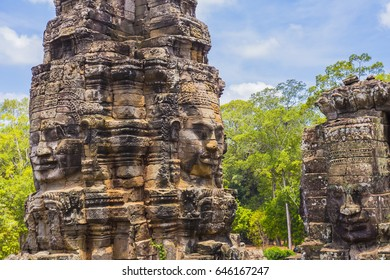 Bayon,Prasat Bayon,Face towers of the Bayon, Location In the center of Angkor Thom.It is best known for its large number of serene faces sculpted on its towers.This is a famous tourist attraction.