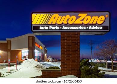 BAYPORT, MN/USA - FEBRUARY 22, 2020: Autozone Automotive parts store at twighlight and trademark logo.