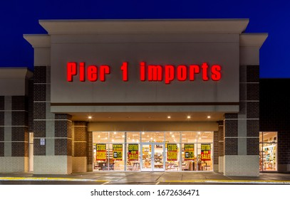 BAYPORT, MN/USA - FEBRUARY 22, 2020: Pier 1 Imports store at twighlight and trademark logo.