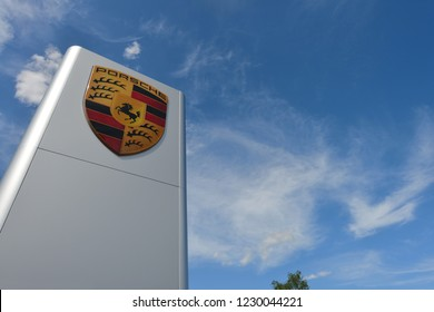 Bayreuth, Bavaria / Germany - May 20, 2018: dealership sign of Porsche against blue sky in Bayreuth, Germany - Porsche is a German automobile manufacturer specialized in high-performance sports cars