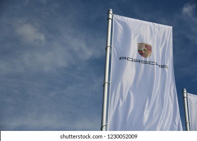 Bayreuth, Bavaria / Germany - May 20, 2018: flags with the sign of Porsche in Bayreuth, Germany - Porsche is a German automobile manufacturer specialized in high-performance sports ca