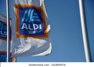 Bayreuth, Bavaria / Germany - May 21, 2018: Flags with the logo of ALDI Süd in Bayreuth, Germany - ALDI is the common brand of two leading global supermarket chains