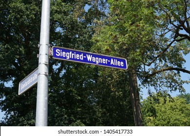 Bayreuth, Germany - August 4, 2018: Siegfried-Wagner-Allee street name sign in Bayreuth, a medium-sized city in northern Bavaria, world-famous for its annual Festival