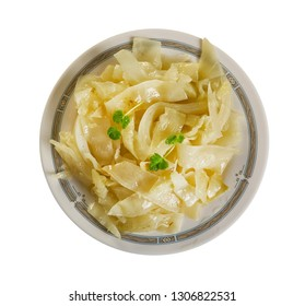 Bayrisch Kraut - Bavarian cabbage, shredded cabbage that is cooked in beef stock with pork lard, onion, apples, and seasoned with vinegar