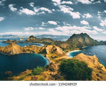 Bays, mountains, cloudy sky. Aerial shot. Padar. Spectacular panoramic overview the bays and mountains of the amazing Padar island of the Komodo National Park. Indonesia. Exotic place to visit.