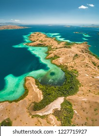 Bays, savanna lands, ocean. Komodo. Aerial view. Spectacular panorama above the stunning bays and savanna territory of Komodo National Park. Indonesia. Heritage Site. Overview drone shot.