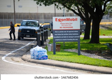 Baytown, Texas - July 31, 2019: Cases of bottled water distributed at the entrance to the ExxonMobil Olefins plant. A fire is burning at  the chemical plant in Baytown