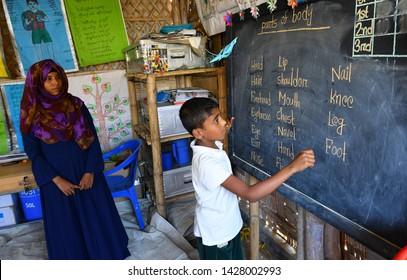 Cox's bazar, Bangladesh - April 05, 2019: Rohingya refugee children attend class at a temporary school in Balukhali refugee camp at Ukhiya in Cox's Bazar, Bangladesh .