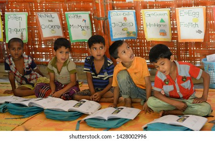 Cox's bazar, Bangladesh - April 05, 2019: Rohingya refugee children attend class at a temporary school in Balukhali refugee camp at Ukhiya in Cox's Bazar, Bangladesh .