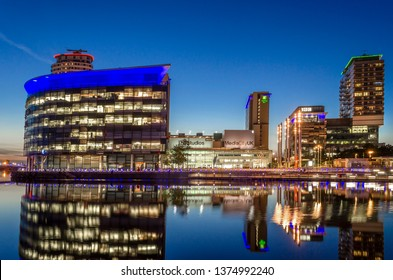 BBC Studios, Media City UK, Salford Quays, Manchester, England, 10th August 2017. The BBC studios at Media City UK with reflections as seen from the Salford quayside at sundown.