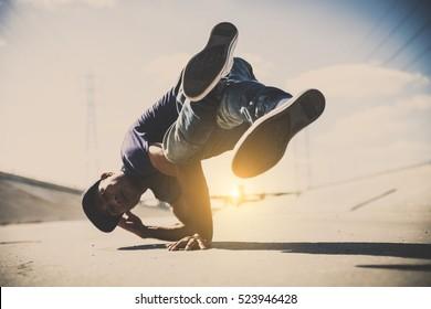 B-boy doing some stunts - Street artist breakdancing outdoors