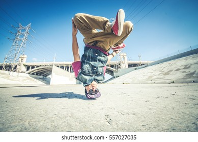 Bboy doing some stunts - Street artist breakdancing outoodrs