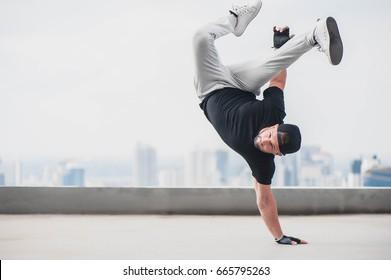 Bboy doing some stunts - Street artist breakdancing outdoors