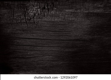 BBQ background. Burnt wooden Board texture. Burned scratched hardwood surface. Smoking wood plank background. Dark Burned wooden texture empty horizontal surface, copy  space