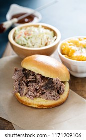 Bbq brisket sandwich with mac and cheese and cole slaw
