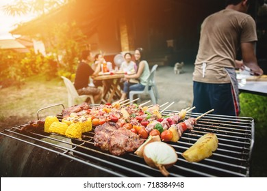 BBQ food party summer grilling meat in the afternoon of weekend happy party of asian people family.