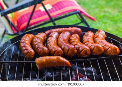 BBQ with fried sausages on the grill