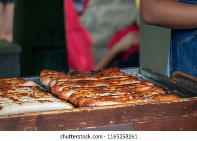 BBQ German Sausages being grilled by a vendor in Borough Market, Southwark, London UK