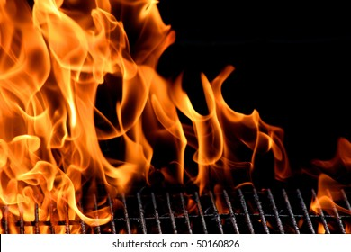 bbq grill flame, hot burning grill, outdoors cooking food. Grill flame burning fire for barbecue cooking outdoors. Big and tall grill flames on the black background