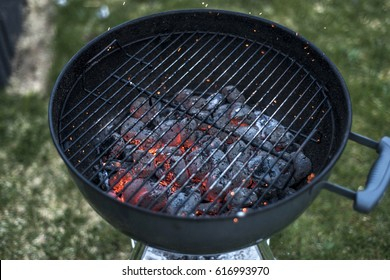 BBQ Grill Pit Glowing And Flaming Hot Charcoal Briquettes coal Food Background Or Texture Close-Up Top View
