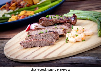 bbq grilled beef steak slices with asparagus and shrimp