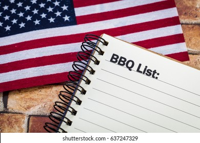 BBQ List concept on notebook with American flag for a patriotic theme