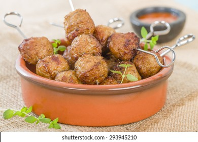 BBQ Meatballs - Meatballs on metal skewers served with chilli dip.