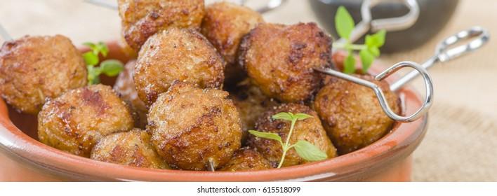 BBQ Meatballs - Meatballs on metal skewers.