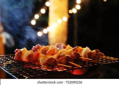 BBQ at the night party.Dinner party, barbecue and roast pork at night