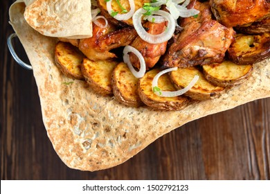 BBQ on pita bread with vegetables on a stand on a brown rustic background. restaurant menu