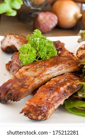 BBQ Pork Spare Ribs with Honey and vegetables In white plate