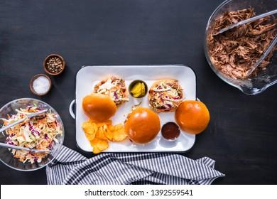 BBQ pulled pork sandwich with coleslaw on brioche buns.