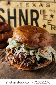BBQ Pulled Pork Sandwich with coleslaw and dill pickles, Texas Style