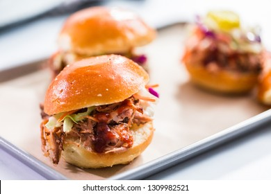 BBQ pulled pork sandwich in shape of small sliders with brioche buns.