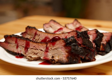 BBQ ribs on a plate with cherry sauce