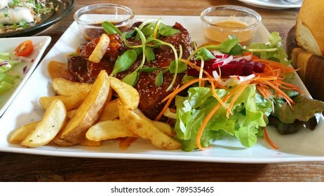 BBQ Ribs with Salad and french fried.