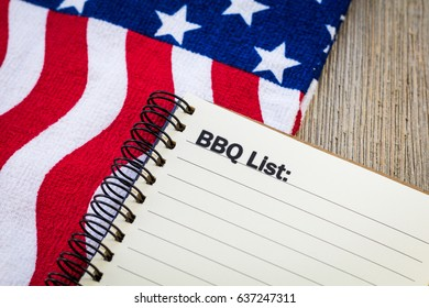 BBQ Theme concept on notebook and wooden board and USA flag banner