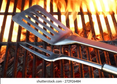 BBQ Tools On The Hot Empty Clean Grill Background Close-up. Summer Outdoor Barbeque Party or Picnic Concept.