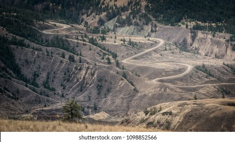 BC, Cariboo Chilcotin District: Farwell canyon road winding its way down through the for this area typical badlands to Farwell canyon where it crosses the Chilcotin river .
