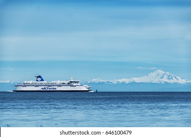 BC Ferries company passenger vessel Spirit of British Columbia on the sea with beautiful Mt Baker background 1. Photo taken at Galiano Island,BC Canada on 2017.05.22