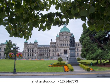 BC Legislature in Victoria, the capital of British Columbia framed by a tree