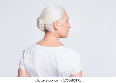 Bcak rear profile side photo of serious lady staring wearing t-shirt isolated over white background