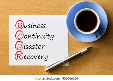 (BCDR) Business Continuity Disaster Recovery - handwriting on notebook with cup of coffee and pen, acronym business concept