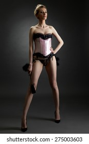 BDSM. Domineering woman posing in sexy lingerie