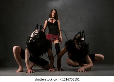 Bdsm erotic perfomance shot in the dark room